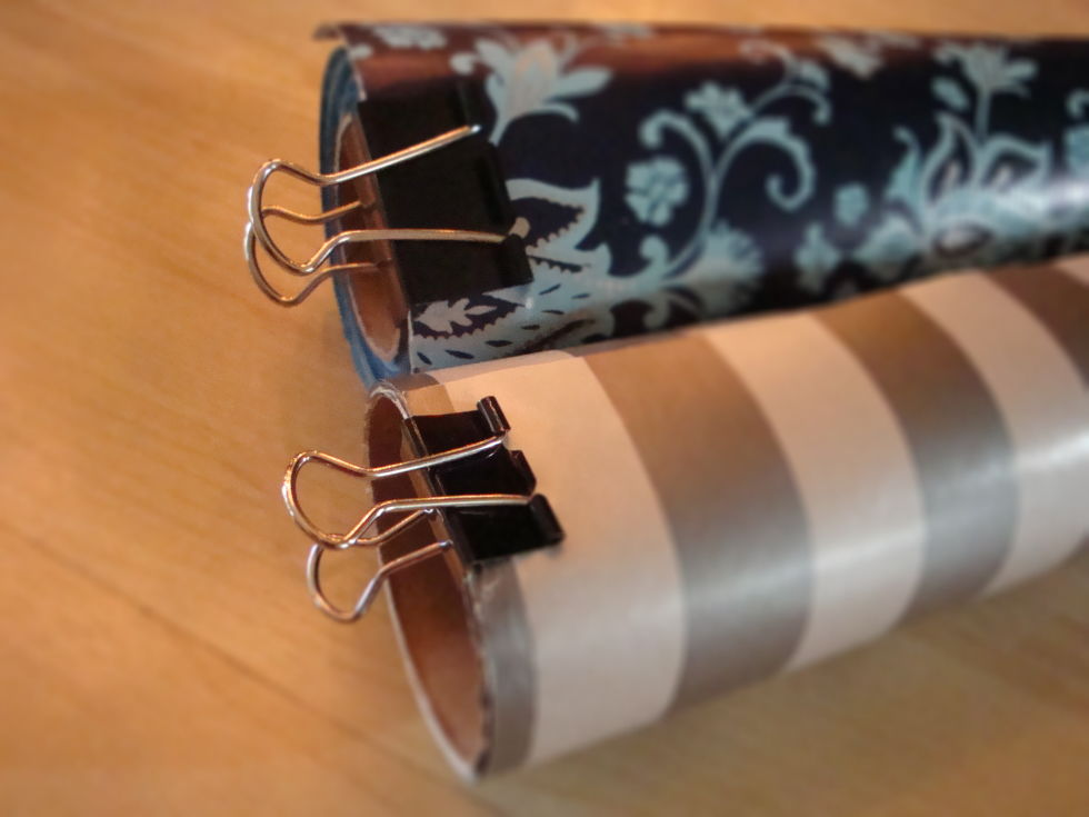 Use binder clips to clip up rolled wrapping papers