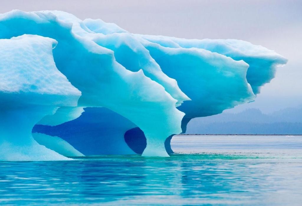 Beautiful blue iceberg drifting in Alaskan waters