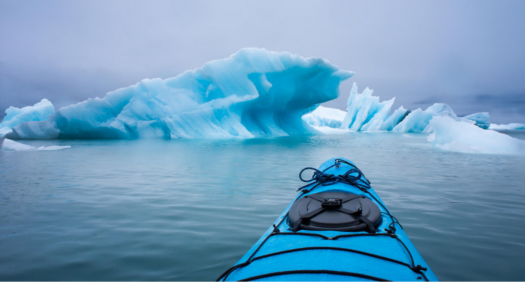Kayaking Near An Iceberg
